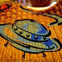 Wochen-Ufo [48]: Eine schlumpfige Mütze